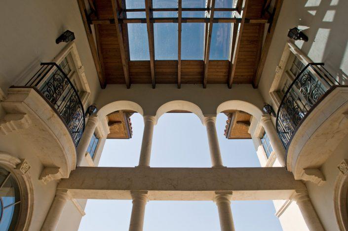 Burden Double Balcony in Crema limestone