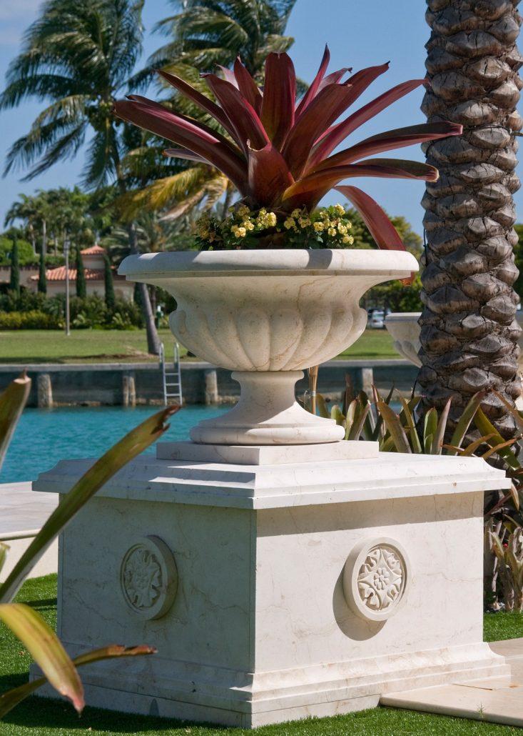 Gold planter with pedestal in Crema limestone